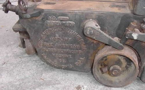 Comments: Embossed Cast Iron Side Of Machine. Source: